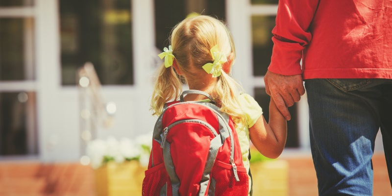 father and little daughter go to school or daycare